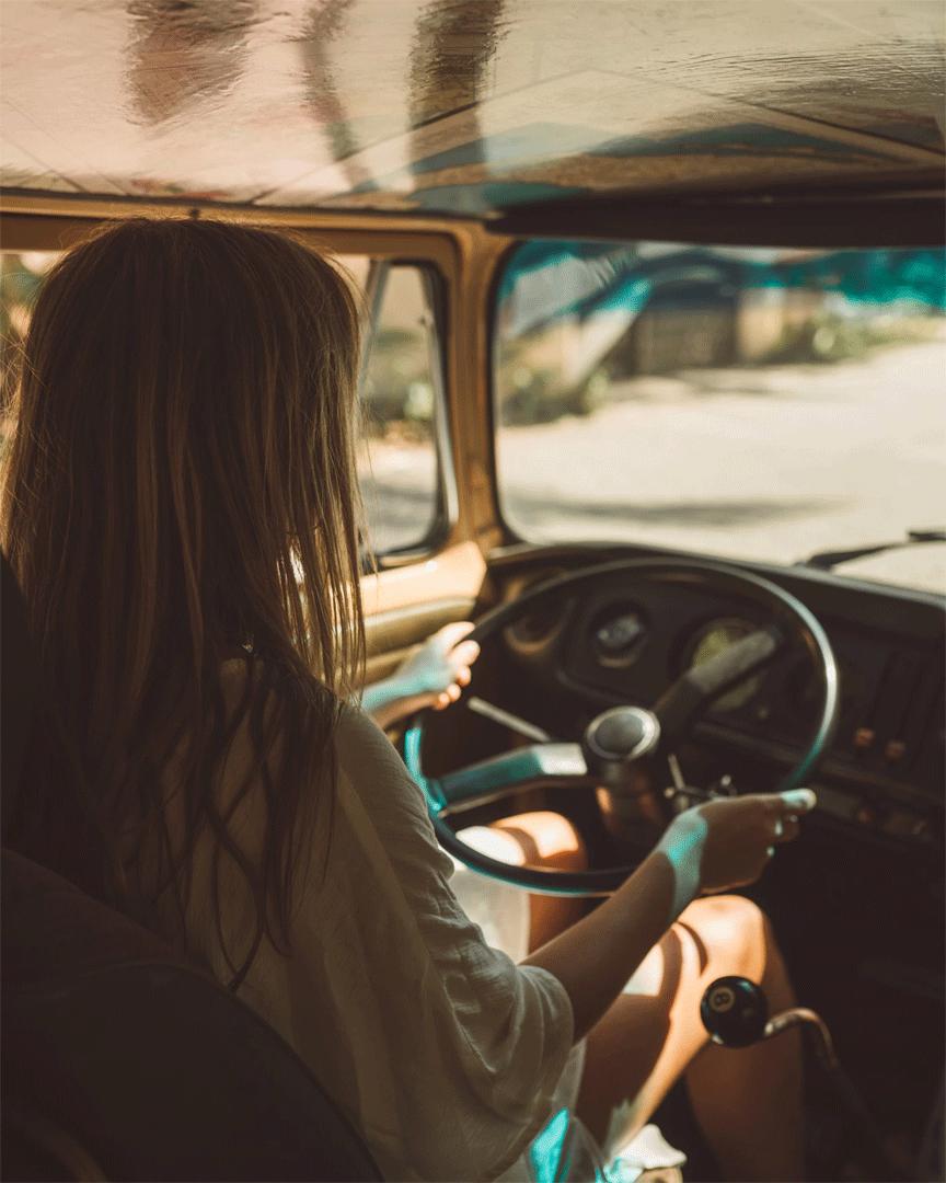 Campervan storage ideas vansage Woman driving VW