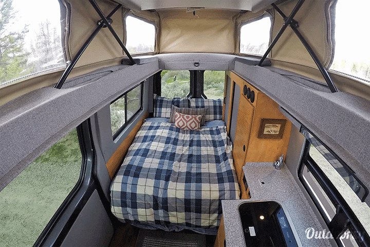 Renting a Sprinter camper van interior bed and kitchen vansage